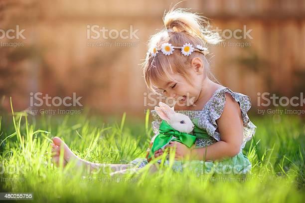 Little girl playing with a bunny on the grass picture id480255755?b=1&k=6&m=480255755&s=612x612&h=pfo bovffev15tmxg6gapmsvboyomhdowoesf6llxjg=