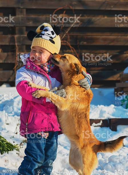 Little girl playing with a mongrel dog in the snow picture id507717270?b=1&k=6&m=507717270&s=612x612&h=f3awhscv4qxioigsgadtxka3bomho4ojkksttcqpsni=