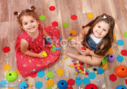 istock Little girl playing with block toys. Toys for kids. 1162198271