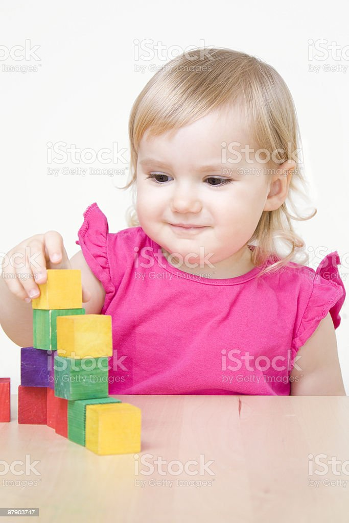 Little girl playing with bricks royalty-free stock photo