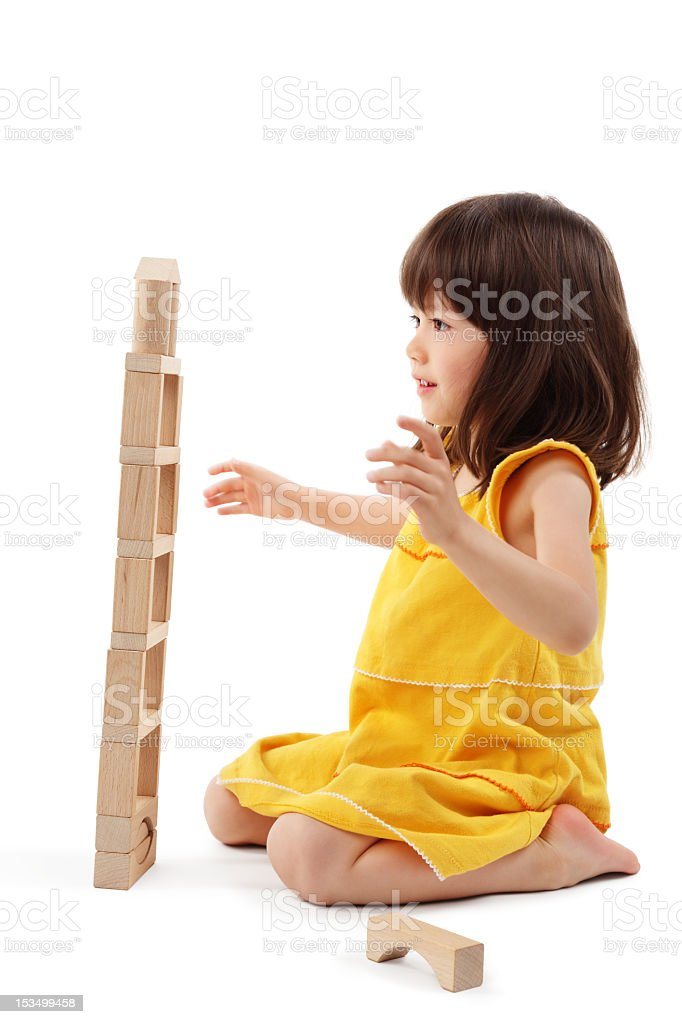 Little Girl Playing With Building Blocks - Isolated stock photo