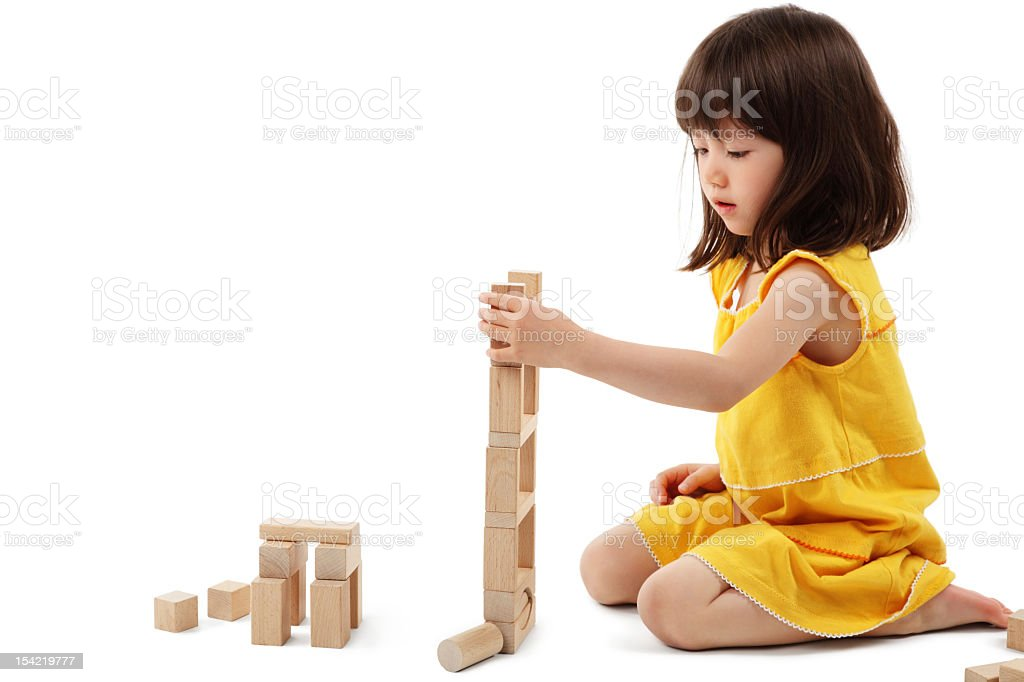 Little Girl Playing With Building Blocks - Isolated royalty-free stock photo