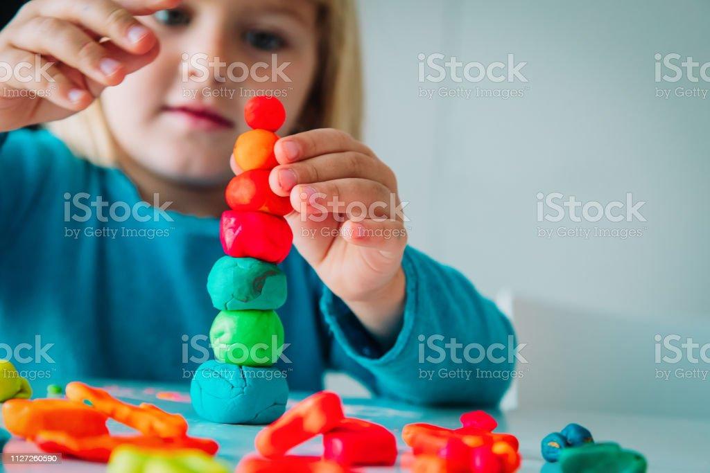 Little girl playing with clay molding shapes, kids crafts - Zbiór zdjęć royalty-free (Budynek przedszkola)
