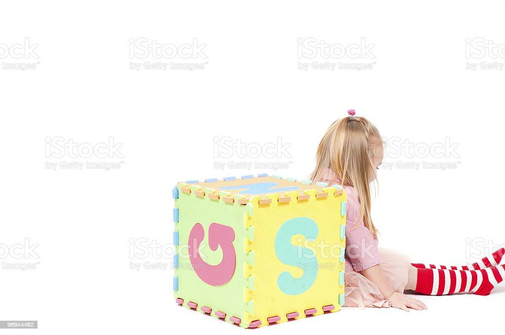 Little girl playing with cube royalty-free stock photo