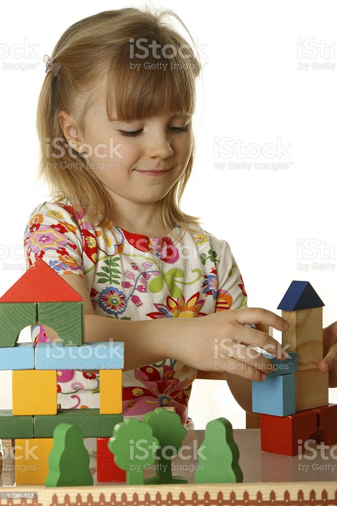 little girl playing with cubes royalty-free stock photo