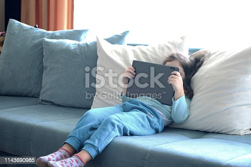 istock Little girl playing with digital tablet 1143690985