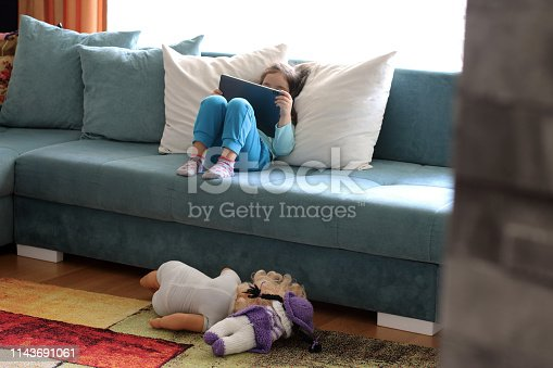 istock Little girl playing with digital tablet 1143691061