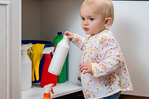 little girl playing with household cleaners - poisonous stock pictures, royalty-free photos & images