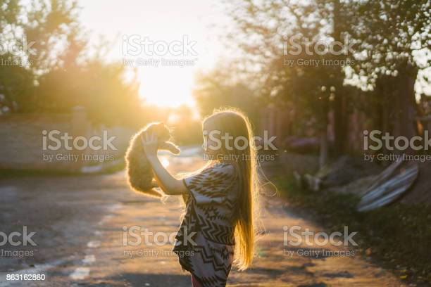 Little girl playing with kittens outdoors picture id863162860?b=1&k=6&m=863162860&s=612x612&h=7g8ny6mvnfekta5nxeqtwwr7vkdvesvbxsjru7djnsa=