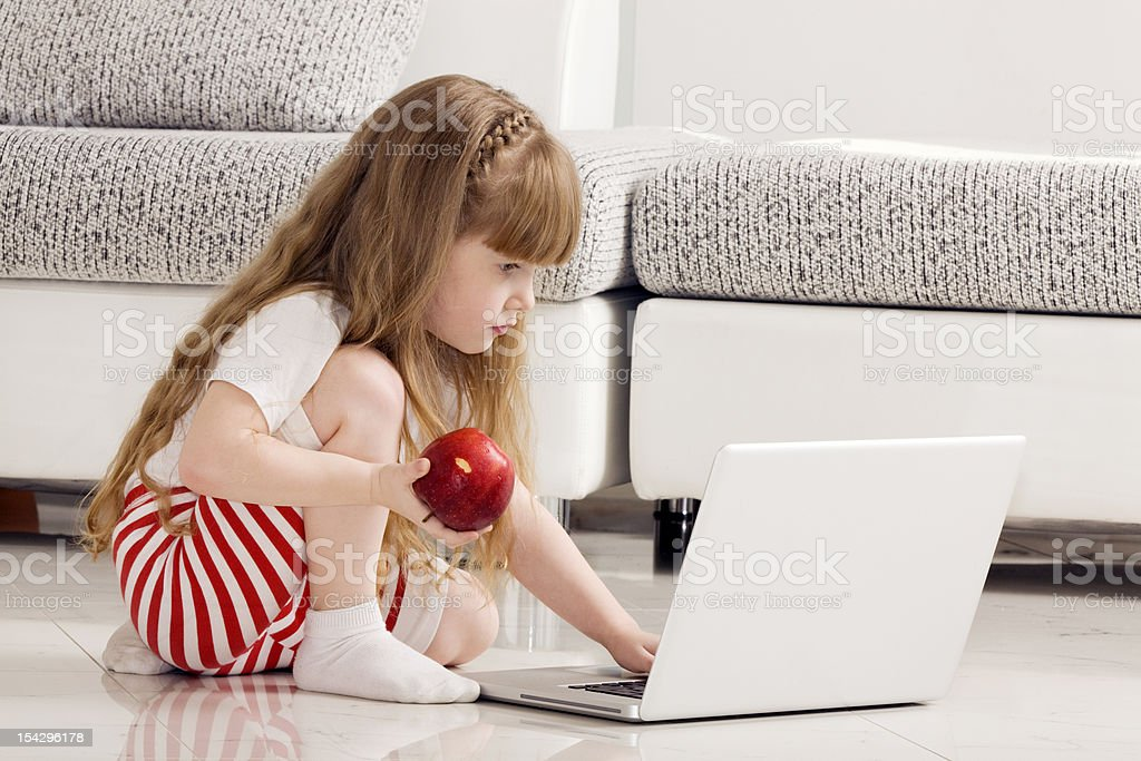Little Girl Playing with Laptop. royalty-free stock photo
