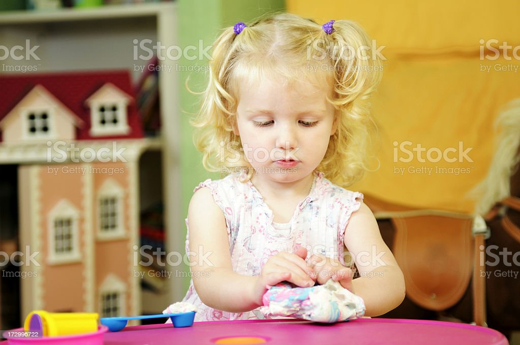 little girl playing with modelling clay royalty-free stock photo