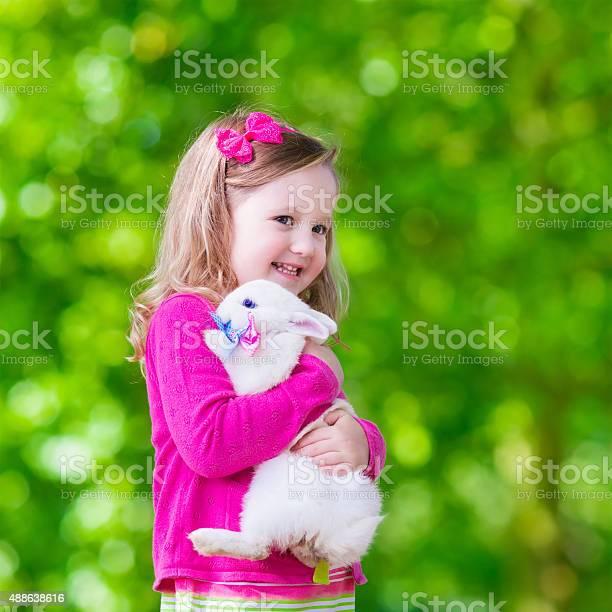 Little girl playing with rabbit picture id488638616?b=1&k=6&m=488638616&s=612x612&h=lxxn2jsvl 3fe 7yvwjdpbez54xu2zeim0pyo9jqkni=