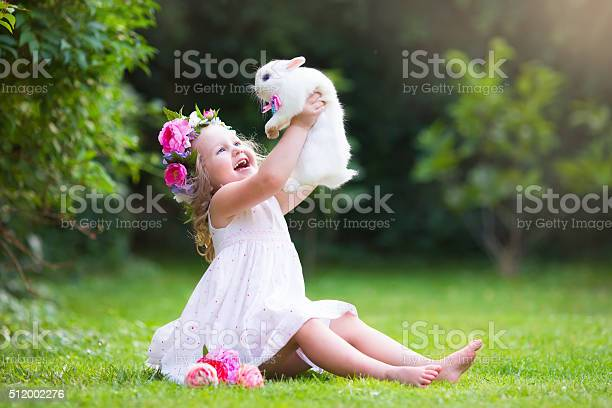 Little girl playing with real rabbit picture id512002276?b=1&k=6&m=512002276&s=612x612&h=l8h3dikqwuueocxlgbhzshdheikh xm64rvxenq5o g=