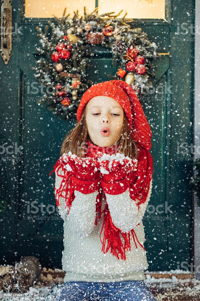Little girl playing with snow stock photo