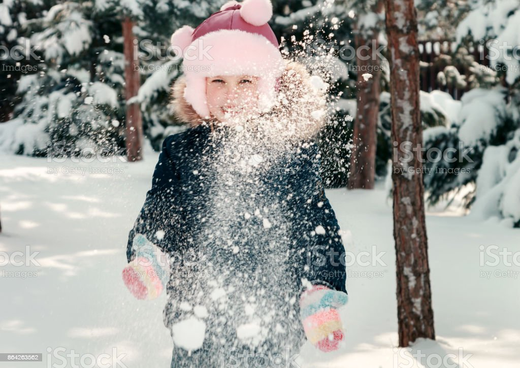 Little girl playing with the snow royalty-free stock photo