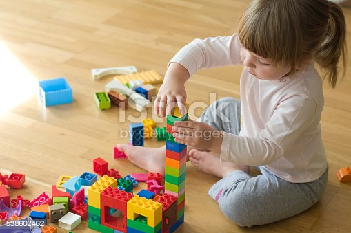 istock little girl playing with toy blocks 538602462