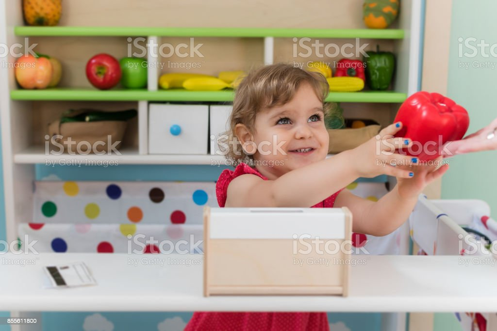 A little girl playing with toys stock photo