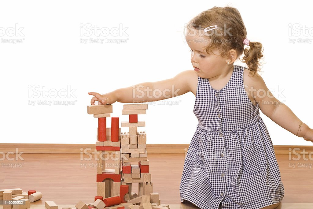 Little girl playing with wooden blocks royalty-free stock photo