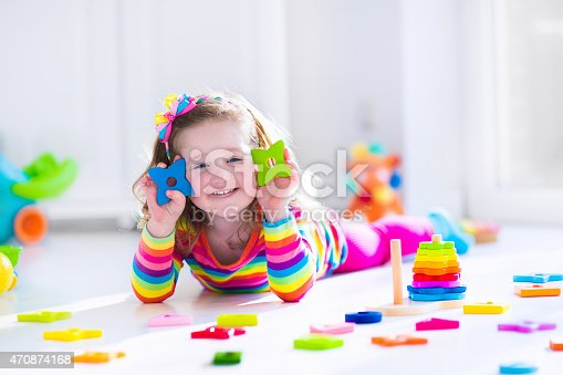 470874196istockphoto Little girl playing with wooden toys 470874168