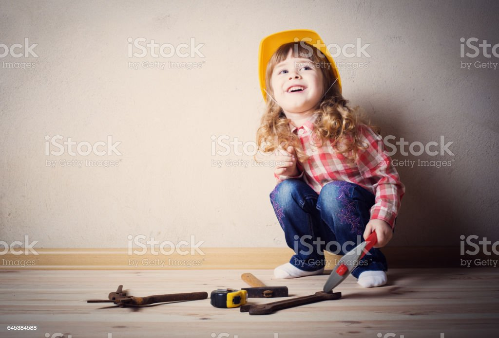 little girl plays in the builder stock photo