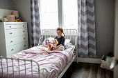 istock Little girl plays on her bed. 1217632819