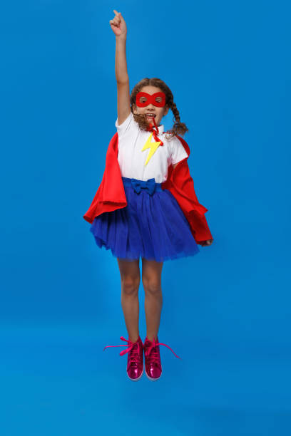 Little girl plays superhero jumping up kid on the background of blue picture id1178863907?b=1&k=6&m=1178863907&s=612x612&w=0&h=wbg2oviajnqng r imtppjmnnnxgbcsdhfgpm2sfuze=
