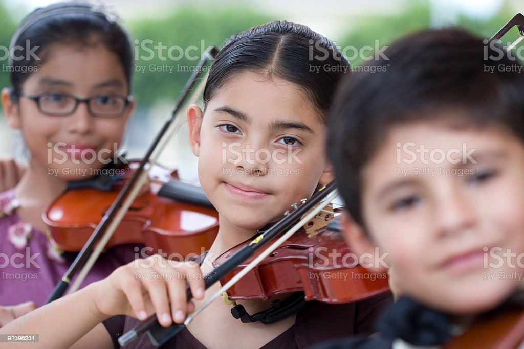 Little girl plays violin in youth orchestra royalty-free stock photo