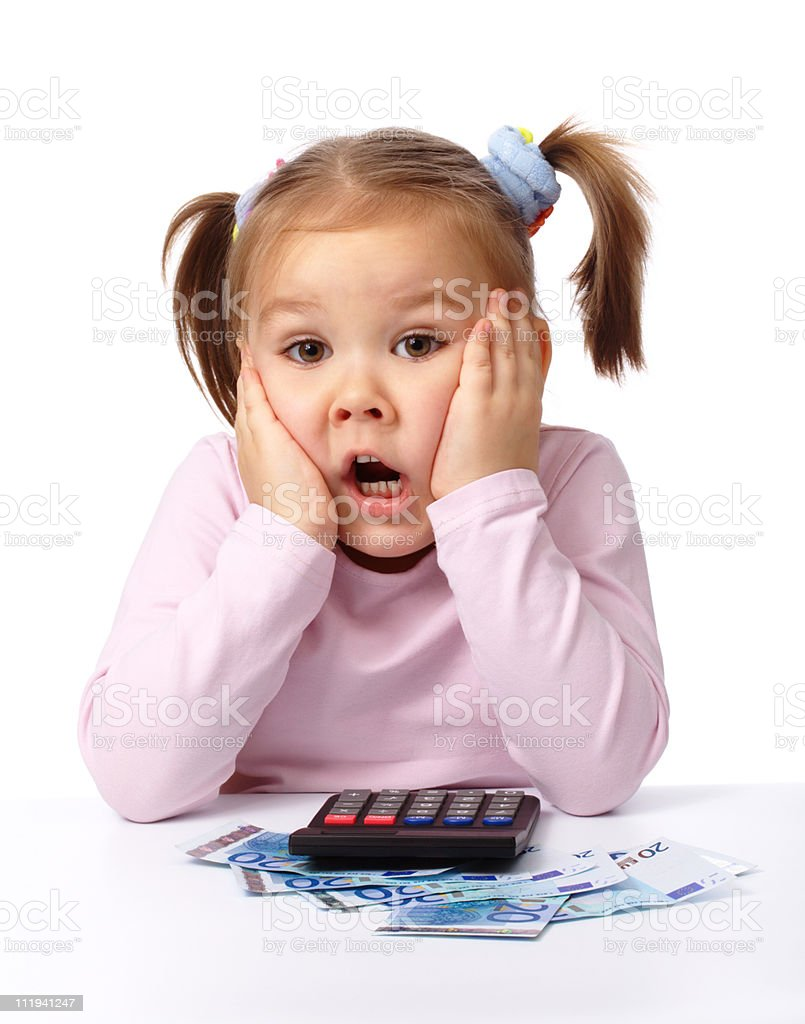 Little girl plays with money, making shocked face royalty-free stock photo