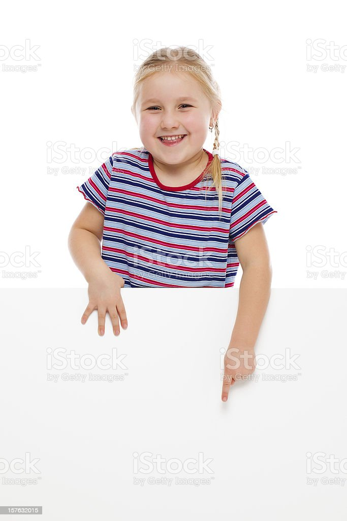 Little girl pointing at whiteboard. royalty-free stock photo