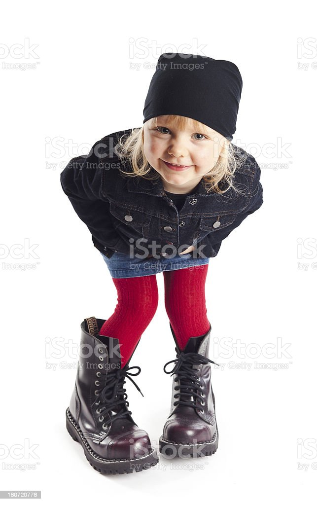 Little girl posing in big boots royalty-free stock photo
