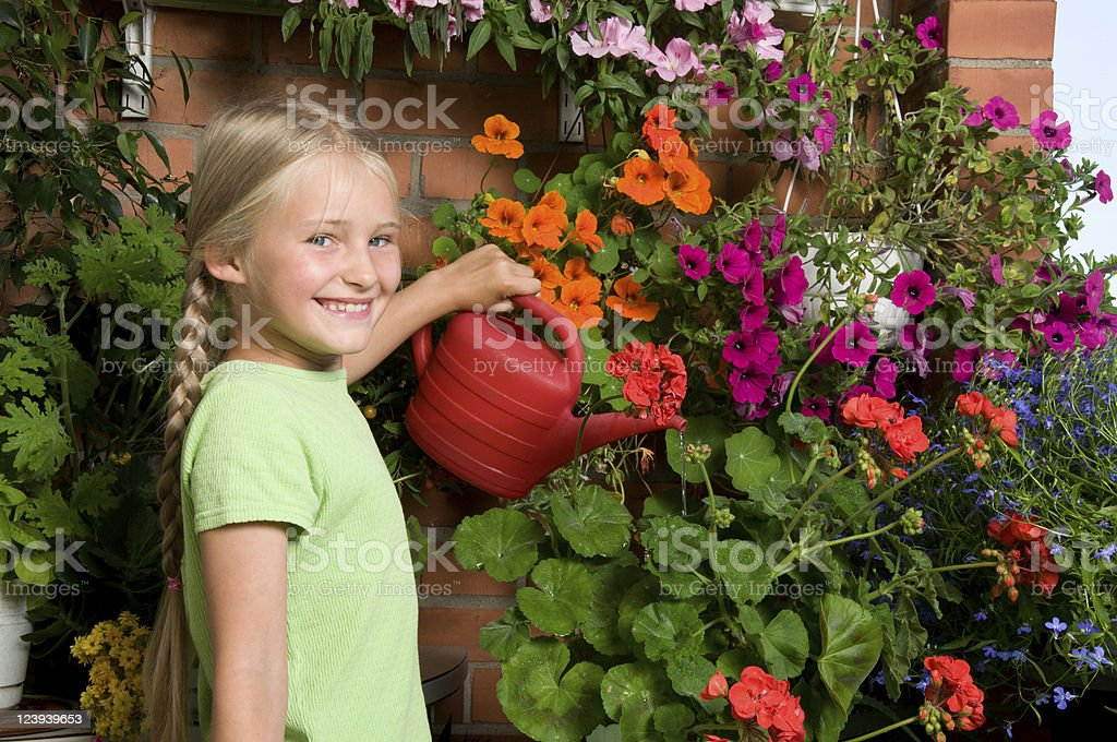 Little girl pouring flowers royalty-free stock photo