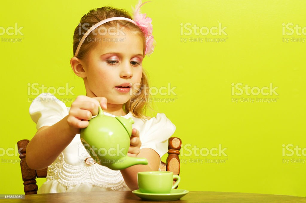 Little Girl Pouring Tea stock photo