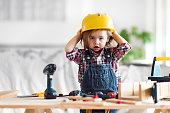 Litte 2 years old girl who dreams of becoming a carpenter