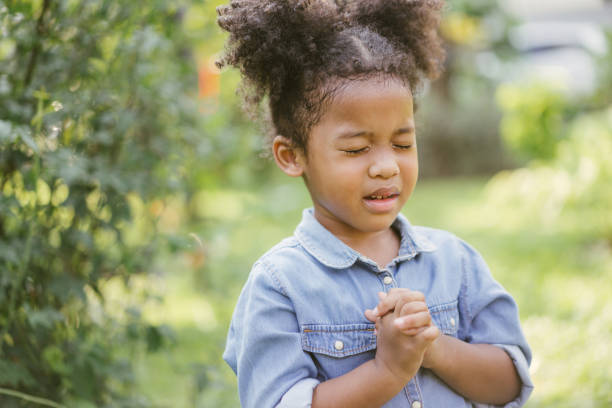 little girl praying hope - african american church stock pictures, royalty-free photos & images