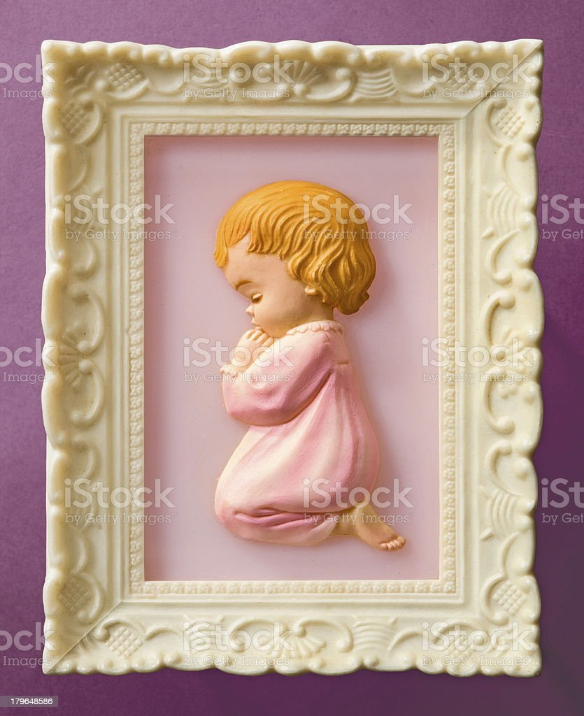 Little Girl Praying in White Frame Picture royalty-free stock photo