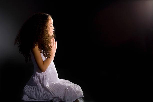 Little Girl Praying, Low Key stock photo