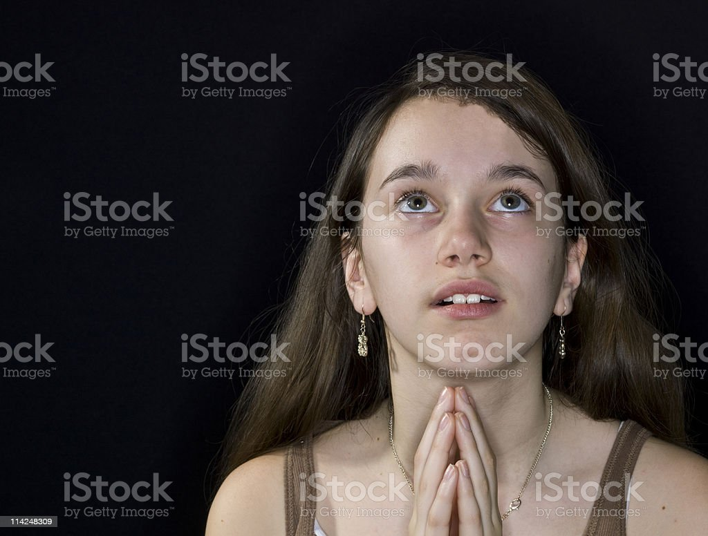 Little girl praying royalty-free stock photo