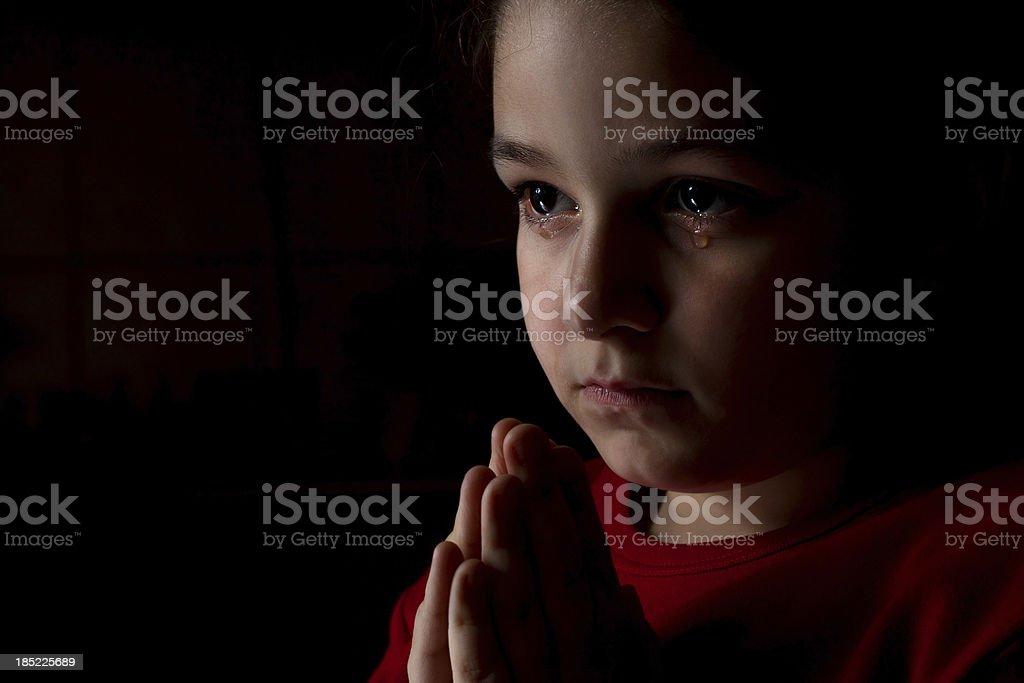 Little girl praying stock photo