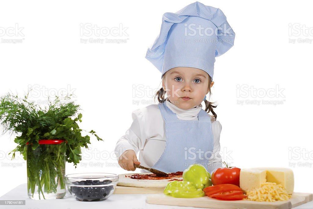 little girl preparing a pizza with vegetables royalty-free stock photo
