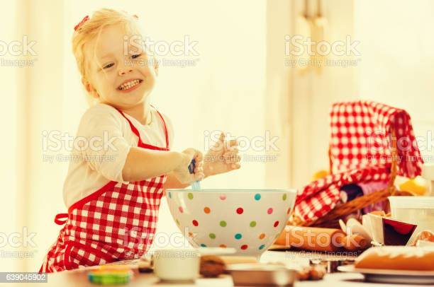 Little girl preparing cakes picture id639045902?b=1&k=6&m=639045902&s=612x612&h=kt2o6rfnvbutzb5mwmnlfqt1gwsit3hhtngswc6q8fs=