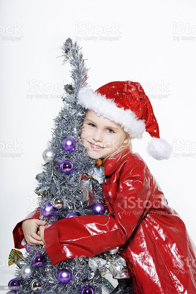 little girl preparing christmas tree royalty-free stock photo