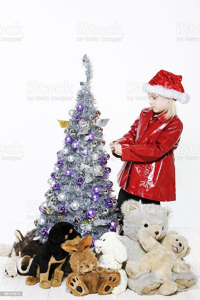 little girl preparing christmas tree royalty-free stock photo