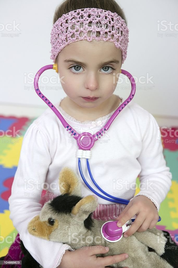 Little girl pretending to be doctor, stethoscope royalty-free stock photo