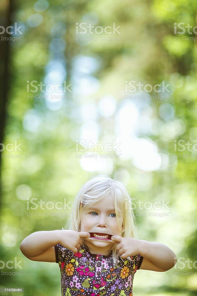 Little girl pulling funny face royalty-free stock photo