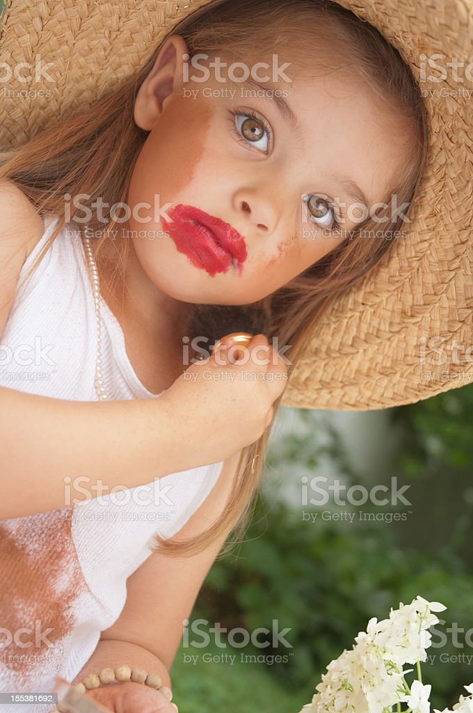 Little girl putting on make-up royalty-free stock photo