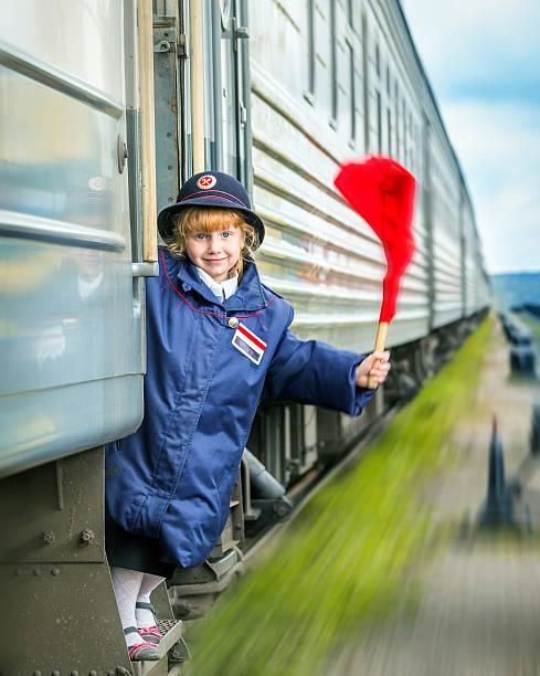 dziewczynka kolejowe przewodnik - konduktor pociągu zdjęcia i obrazy z banku zdjęć