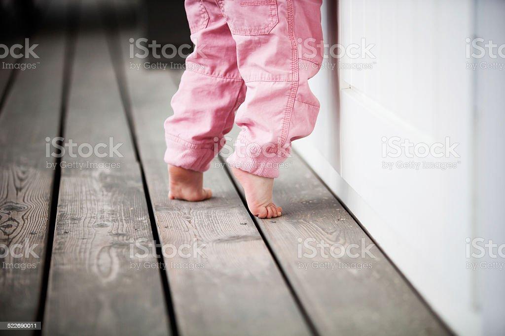 Little girl reaching up stock photo