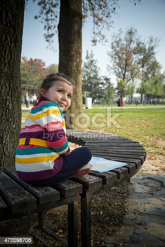 862602714 istock photo Little girl read book 472098705
