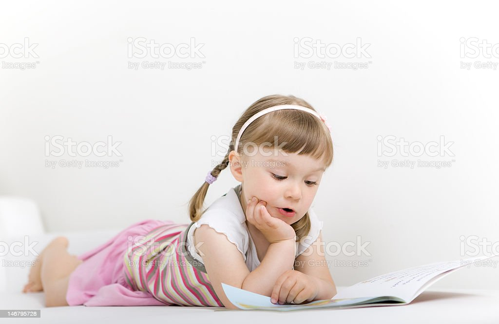 little girl reading book royalty-free stock photo