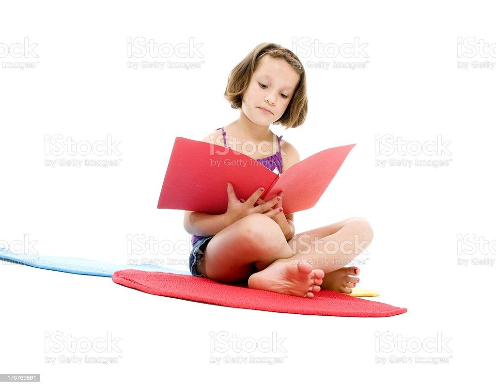 Little Girl Reading on Carpet royalty-free stock photo